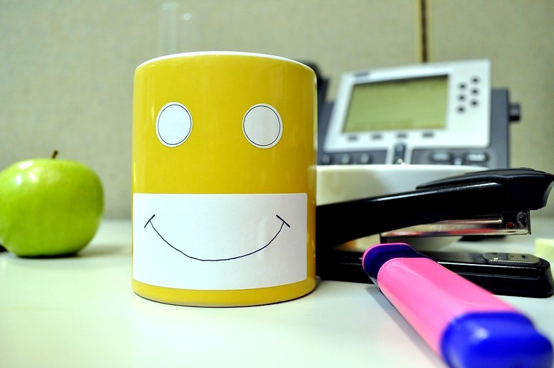 A yellow mug with a happy face