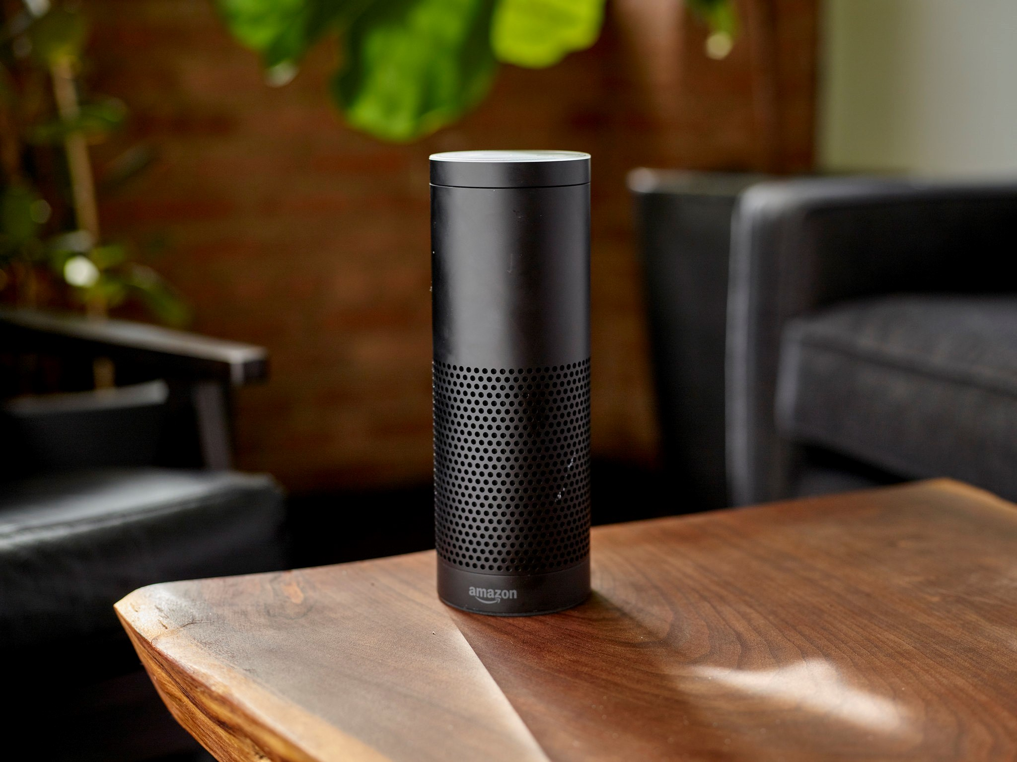 Amazon speaker standing on wooden table